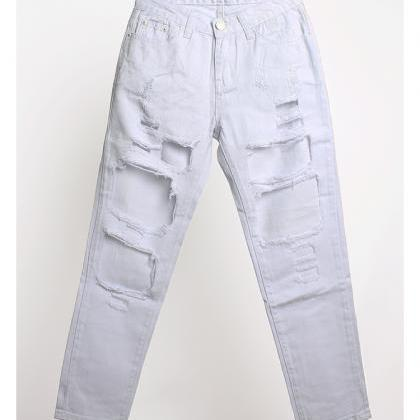 White Heavily Distressed Mom Jeans